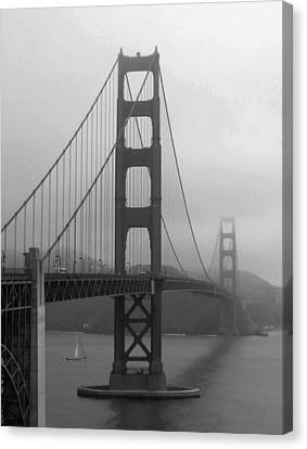 Sailboat Passing Under Golden Gate Bridge Canvas Print by Connie Fox