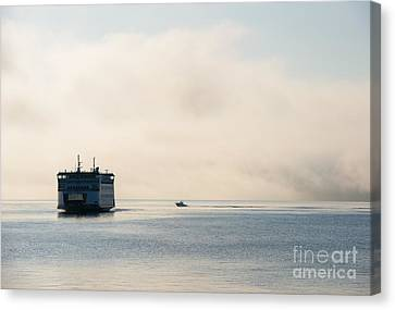 Salish Into The Fog Canvas Print by Mike  Dawson