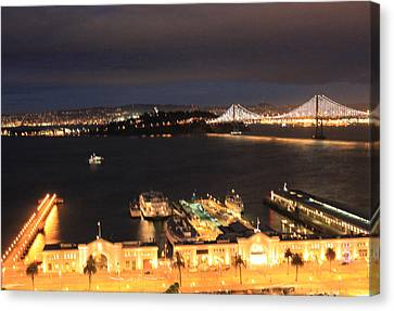 San Francisco Embarccadero And Bay Bridge Lights Canvas Print by Ron McMath