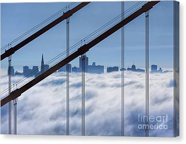 San Francisco Skyline In Fog Canvas Print by Jerry Fornarotto