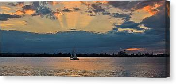 San Juan Bay Sunset And Sailboat Canvas Print by Ricardo J Ruiz de Porras