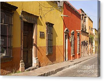 San Miguel Street Mexico Canvas Print by John  Mitchell