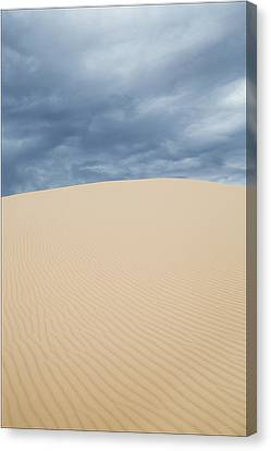 Sand Dunes And Dark Clouds Canvas Print