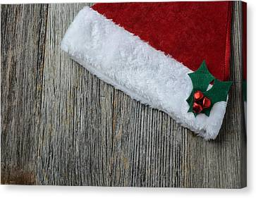 Holly Berry Still Life Canvas Print - Santa Hat On Rustic Wood Background by Brandon Bourdages