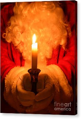 Santa Holding Candle Canvas Print