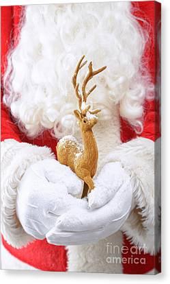 Santa Holding Reindeer Figure Canvas Print by Amanda Elwell