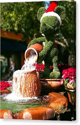 Canvas Print featuring the photograph Santa Mickey Topiary Fountain by Doug Kreuger