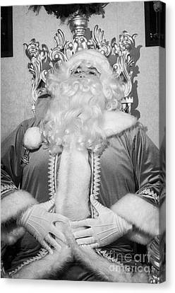 Santa Sitting On His Throne Laughing With Hands On Belly In Grotto Set Up Canvas Print by Joe Fox