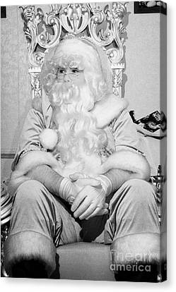 Santa Sitting On His Throne Looking Away From Camera In Grotto Set Up  Canvas Print
