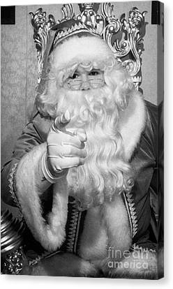 Santa Sitting On His Throne Pointing To Camera In Grotto Set Up Canvas Print by Joe Fox