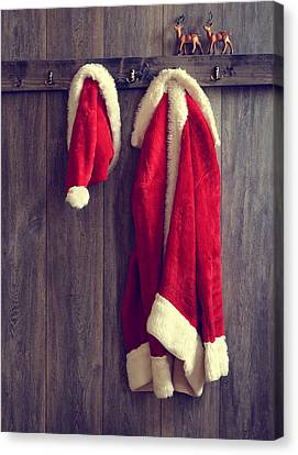 Santa's Hat And Coat Canvas Print by Amanda Elwell