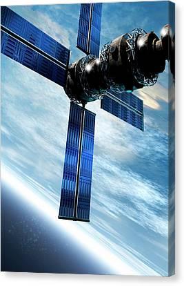Satellite Orbiting The Earth Canvas Print