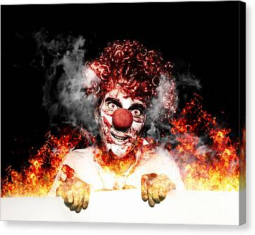 Scary Clown Holding Blank Board In Flames And Fire Canvas Print by Jorgo Photography - Wall Art Gallery