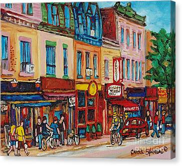 Schwartzs Deli And Warshaw Fruit Store Montreal Landmarks On St Lawrence Street  Canvas Print