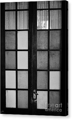 screen door in traditional old house in the barrio paris londres Santiago Chile Canvas Print