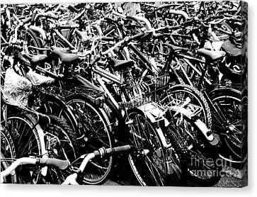 Canvas Print featuring the photograph Sea Of Bicycles 2 by Joey Agbayani