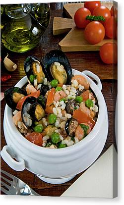 Seafood Rice With Mussels, Shrimps Canvas Print by Nico Tondini