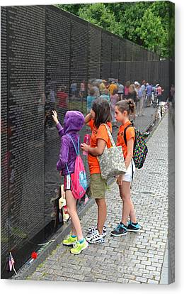 Searching A Loved Ones Name On The Vietnam Veterans Memorial Canvas Print by Jim Fitzpatrick