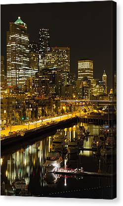 Canvas Print featuring the photograph Seattle Downtown Waterfront Skyline At Night by JPLDesigns