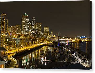 Canvas Print featuring the photograph Seattle Downtown Waterfront Skyline At Night Reflection by JPLDesigns