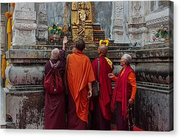 Seeking Blessings Of Budha Canvas Print by Mukesh Srivastava