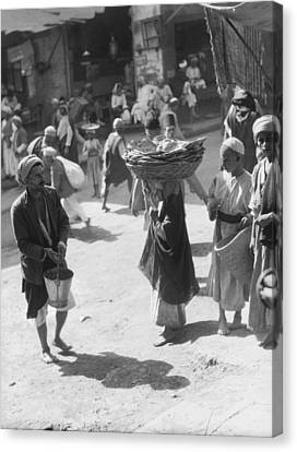 Selling Bread In Baghdad Canvas Print by Underwood Archives