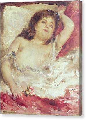 Semi-nude Woman In Bed The Rose Canvas Print by Pierre Auguste Renoir