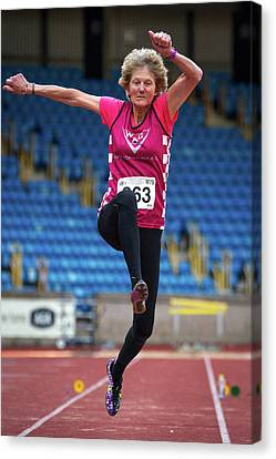 Senior British Female Athlete Mid-air Canvas Print by Alex Rotas