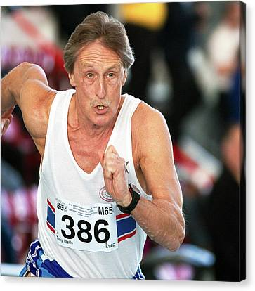 Senior British Masters Athlete Running Canvas Print by Alex Rotas