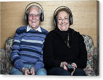 Senior Couple Wearing Headphones Canvas Print