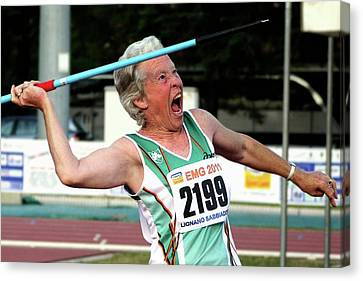 Senior Female Athlete Throws Javelin Canvas Print by Alex Rotas