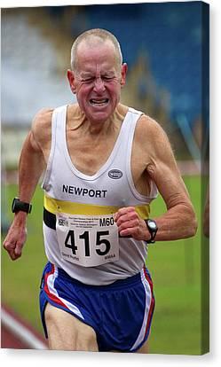 Senior Male Athlete Runs Through The Pain Canvas Print