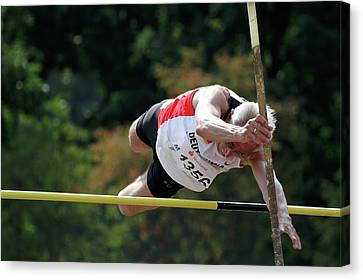 Senior Pole Vaulter Clearing The Bar Canvas Print by Alex Rotas