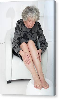 Senior Woman Touching Her Legs Canvas Print by Lea Paterson