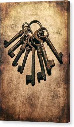 Set Of Old Rusty Keys On The Metal Surface Canvas Print by Jaroslaw Blaminsky