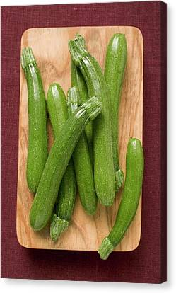 Several Courgettes On Chopping Board Canvas Print