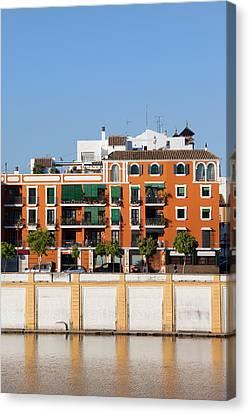 Seville House River View Canvas Print by Artur Bogacki