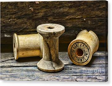 Sewing Vintage Wood Spools Canvas Print by Paul Ward