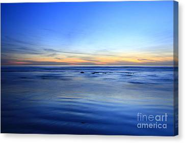 Canvas Print featuring the photograph Rocks In Surf Carlsbad by John F Tsumas