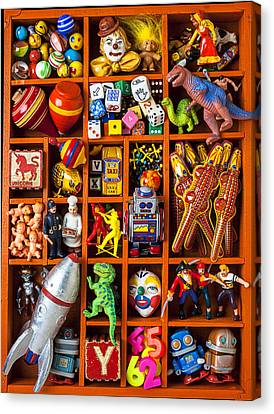 Shadow Box Full Of Toys Canvas Print by Garry Gay