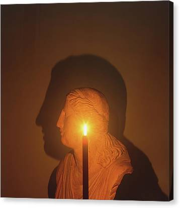 Shadow Of A Bust In Candle Light Canvas Print