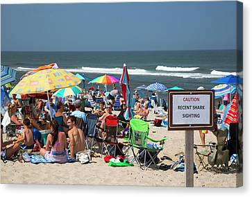 Shark Warning On A Beach Canvas Print by Jim West