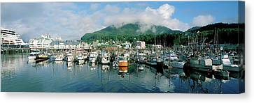 Ships And Boats Moored At A Harbor Canvas Print by Panoramic Images