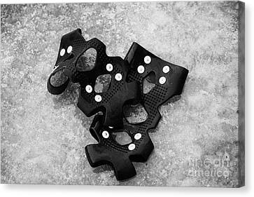 Shoe Spiked Grips On Melting Ice And Snow On Street Surface Canvas Print by Joe Fox