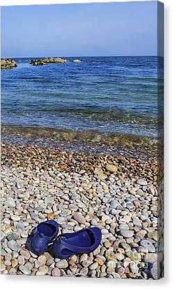 Shoes On Pebbles Canvas Print by Diane Macdonald