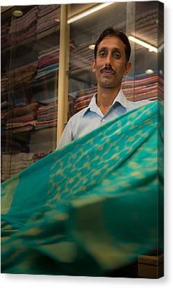 Shopkeeper - India Canvas Print by Matthew Onheiber
