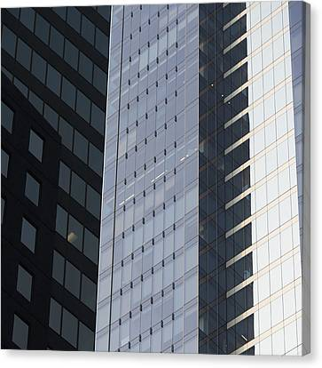 Side Of An Office Towers With Glass Canvas Print by Keith Levit
