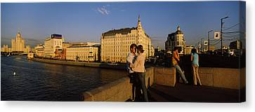 Side Profile Of A Couple Romancing Canvas Print