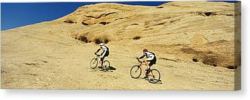 Side Profile Of Two Men Mountain Canvas Print