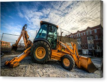 Side View Of A Backhoe At Sunset Canvas Print